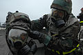 Members of the 41st Helicopter Maintenance Unit do buddy checks on each other chemical warfare gear in alarm black during exercise Commando Angel on March 22, 2007 at Moody Air Force Base, Georgia 070322-F-JI436-127.jpg
