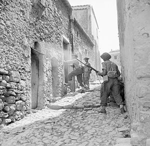 Men of the 6th Inniskillings, 38th Irish Brigade, searching houses during mopping up operations in Centuripe, Sicily, August 1943. NA5388.jpg