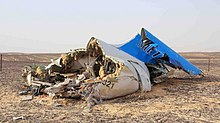Metrojet 9268 tail section wreckage.jpg