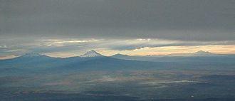 Trans-Mexican Volcanic Belt - Six Mexican Volcanoes Left to right Ixtaccíhuatl, Popocatépetl, Matlalcueitl (Malinche), Cofre de Perote (most distant), Pico de Orizaba, Sierra Negra
