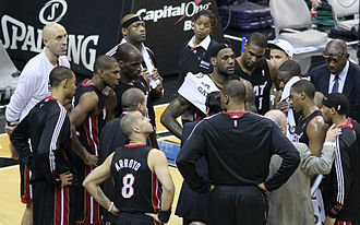 2010–11 Miami Heat season - Members of the 2010–11 Miami Heat team and coaching staff during a timeout.