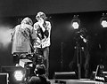 Mick Jagger and Mick Taylor being filmed in Hyde Park (2013).jpg
