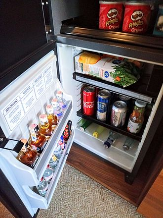 Minibar - A refrigerated minibar in a Grand Hyatt hotel, filled with beverages. This minibar detects whenever an item is removed, and charges the guest instantly.
