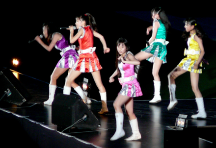 In 2015, Kiss released a collaboration CD with another artist for the first time. The artist was Momoiro Clover Z, the most popular female idol group according to 2013 and 2015 surveys in Japan. Momoiro Clover Z LIVE 1.png