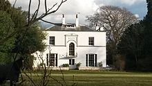 A south-side view of Mulberry House, the former rectory. A horse which belongs to the grounds is shown directly to the left