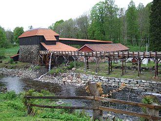 Næs jernverk - Næs ironworks, restored furnace building with waterwheel