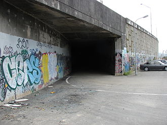 Ngauranga railway station - Entrance to the tunnel formerly used by the Ngauranga Industrial Siding (Wellington Meat Export Company) from the Ngauranga railway station yard, now the access road to the waste disposal facility.