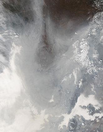 2013 Northeastern China smog - Smog (grey) and fog (white) cloak northeast China on 21 October 2013.