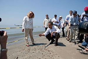 Timeline of the Deepwater Horizon oil spill (May 2010) - Lafourche Parish, Louisiana President Charlotte Randolf and President Obama inspect tarballs on Port Fourchon, Louisiana beach on May 28.