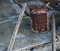 Oil can on north rear porch of farmhouse at Kelvin A. Lewis farm in Creeds.jpg