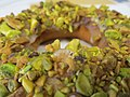 Orange honey pistachio doughnut (10986022935).jpg
