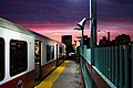 Outbound Red Line train at Charles MGH with sunset, November 2014.jpg