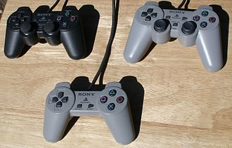 Dual Analog Controller - Clockwise from top left, DualShock, Dual Analog Controller and original PlayStation Controller.