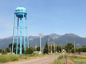 Pablo, Montana - Blue water tower and railroad crossing in Pablo, Montana, July 15, 2013.