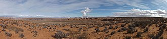 Navajo Generating Station - Winter panorama showing the city of Page, the Navajo Generating Station, and Leche'e Rock (left to right, looking east near center). Water vapor from the plant's stacks and cooling towers forms a large plume due to the cold air and relative humidity.