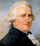 Head and shoulders portrait of a white-haired, portly, middle-aged man with a pinkish complexion, blue velvet coat and a ruffle