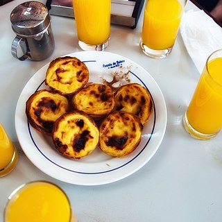 Pastel de nata Portuguese egg tart pastry dusted with cinnamon