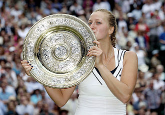 Petra Kvitová - Kvitová holds the Venus Rosewater Dish, her first Grand Slam tournament crown, after winning the 2011 Wimbledon Championships