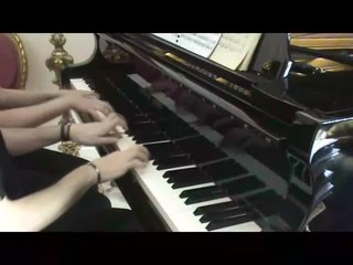 Piano four hands type of piano duet involving two players playing the same piano simultaneously