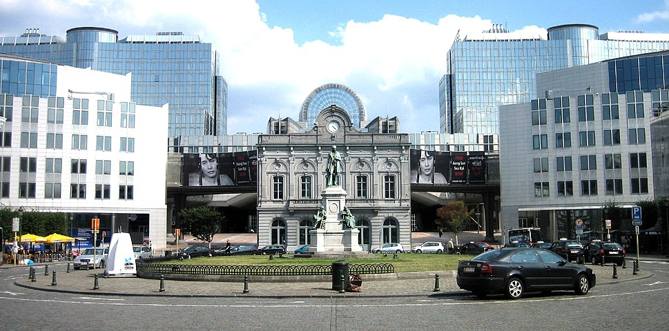 Place du Luxembourg, European Quarter of Brussels (Belgium). View of the European Parliament (western side), including converted station entrance in front) with statue of the industrialist John Cockerill in foreground.