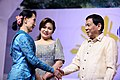 President Duterte and his partner Honeylet welcome Aung San Suu Kyi prior to the start of the 31st ASEAN Summit.jpg