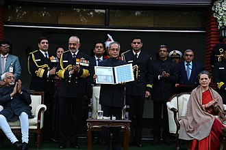 Sonia Gandhi - Sonia Gandhi with 13th President of India Pranab Mukherjee on releasing the first day cover of INS Vikramaditya in 2013.