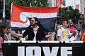 Protester carrying the Tino Rangatiratanga flag with writing on it at the Stand Against Racism protest in Auckland city, Sunday 24 March 2019.jpg