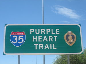 Purple Heart - Sign on Interstate 35 designating the Purple Heart Trail.