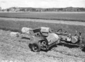 Queensland State Archives 1696 Sliced hay baler in lucerne field c1953.png