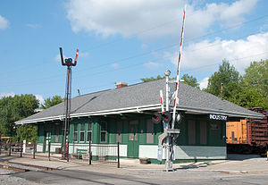 Rochester & Genesee Valley Railroad Museum - The former Erie Railroad depot in 2010. The semaphore train order signal and milepost denoting the length to Jersey City, New Jersey are visible.