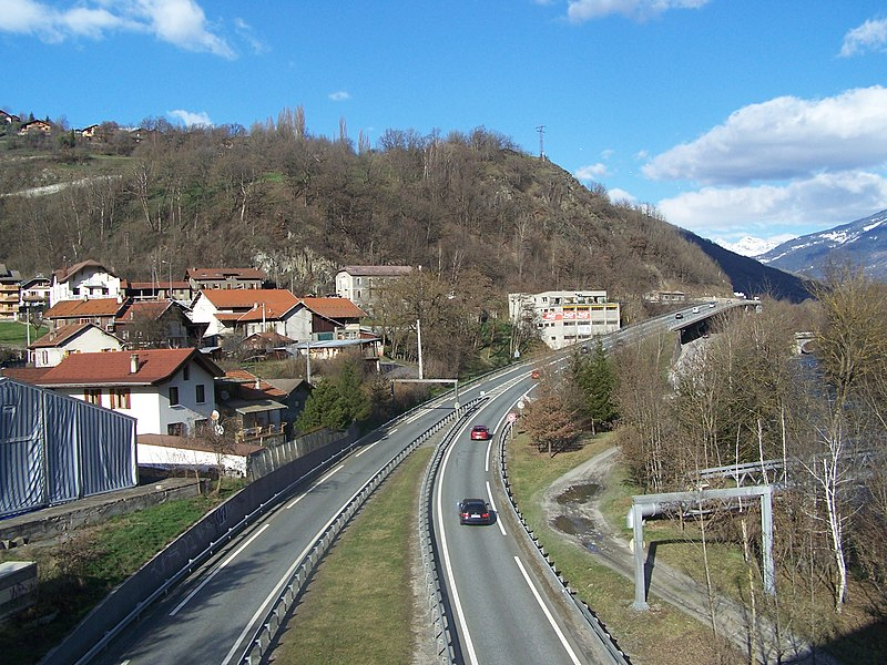 The French National Road N°90, seen from the railway line when entering the city of Aime in Savoie, France.