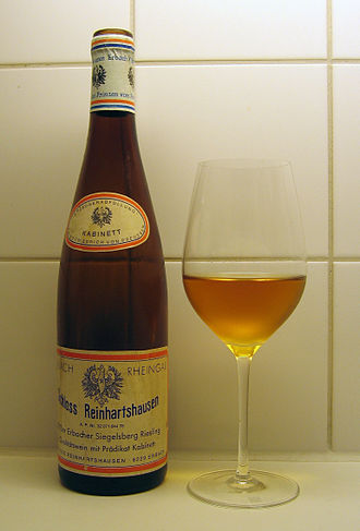 Riesling - A German Riesling from the 1975 vintage, an Erbacher Siegelsberg Kabinett from Schloss Reinhartshausen in Rheingau, uncorked at 32 years of age in 2007. It shows the typical golden to amber colour of aged Riesling, which is shared by many other aged white wines.