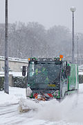 Road sweeper clearing snow away in Paris.jpg