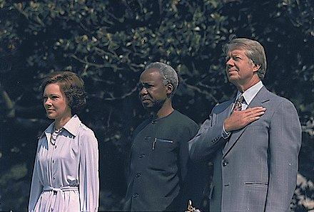 First Lady Rosalynn Carter, Tanzanian leader Julius Nyerere, and Carter, 1977 Rosalynn Carter, President Julius Nyerere of Tanzania and Jimmy Carter (1977).jpg