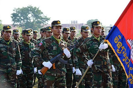 Royal Cambodian Army officers marching Royal Cambodian Army soldiers, 2014.jpg