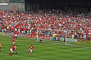 A player scores a penalty kick given after an offence is committed inside the penalty area
