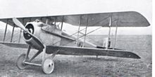 Military biplane parked on airfield