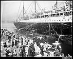 SS CERAMIC departing the White Star Line wharf in Millers Point, with crowds and streamers, 1920-1939 (7869544302).jpg