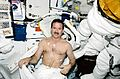 STS-100 Hadfield prepares for EVA.jpg