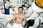 STS-100 Hadfield prepares for EVA.jpg