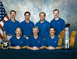 Near Infrared Camera and Multi-Object Spectrometer - NICMOS was installed by the crew of STS-82, this Space Shuttle mission in 1997 also installed the STIS instrument on Hubble Space Telescope, a scale model of the telescope is shown with this crew photo