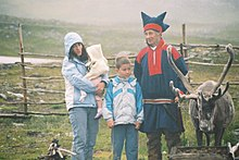 Sami people with a reindeer.jpg