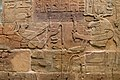 Sandstone wall of King Aspelta offering Ma'at (Truth) to ram-headed god Amun-Re accompanied by Anukis, Temple T at Kawa.jpg