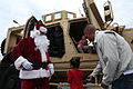 Santa brings food, fun to families on Camp Foster 141221-M-TA471-476.jpg