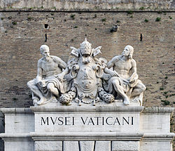 Sculptures above the entrance of Vatican Museums.jpg