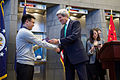 Secretary Kerry Presents Chinese IBM Employee With First 10-Year Business and Tourism Visa Under Deal Announced by Presidents Obama and Xi.jpg