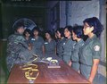 Sergeant Sans instructs WAC class on pack closing the T-10 Parachute at the 90th Aerial Equipment Depot, Saigon. - NARA - 530629.tif