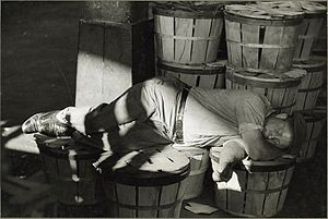 "Sheldon Dick - One of Dick's FSA photographs: ""Man Sleeping in a Fish Market, Baltimore, Maryland,"" July 1938."