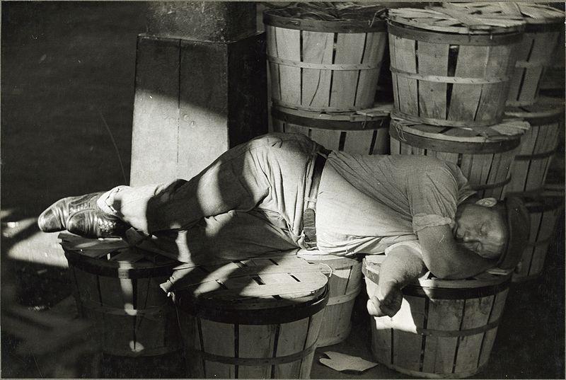 Man sleeping in fish market. Baltimore, Maryland.