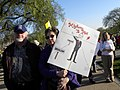 Sign with Obama on the road to socialism, communism and fascism at a Tea Party rally (4526043030).jpg